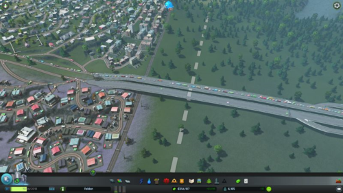 A long line of traffic on the highway going into the city.