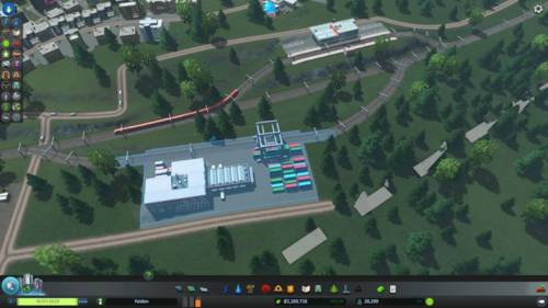 Two train stations (one cargo, one passenger) built close together, with roads and rails clearly adjusted to fit the stations.